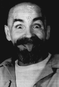25 Aug 1989, California, USA --- Charles Manson clowns around as he is led to his cell upon the conclusion of his exclusive interview with Reuters August 25, 1989. | Location: Corcoran, California, USA. --- Image by © CALVIN HOM/Reuters/Corbis