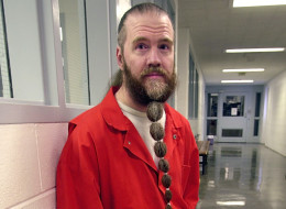 FILE - In this June 30, 2003, file photo, Dan Lafferty poses for a photograph, at Utah State Prison in Draper, Utah. A Utah couple who overdosed on drugs along with their three children was obsessed with Lafferty, a murderer who sees himself as a prophet. Kristi and Benjamin Strack visited Lafferty for years before their visiting privileges were cut off, developing a close friendship as part of an increasingly bizarre mindset that culminated with a belief that the apocalypse was near. (AP Photo/Douglas C. Pizac, File)